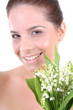 Young beautiful healthy woman with flowers Royalty Free Stock Images