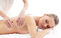 A young, beautiful and healthy woman getting spa treatment Stock Images