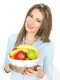 Young Beautiful Healthy Woman Holding a Basket of Fruit Royalty Free Stock Photos