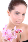 Young beautiful healthy woman with orchid. Portrait of a young beautiful healthy woman with orchid Royalty Free Stock Photo