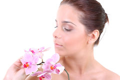 Young beautiful healthy woman with orchid. Portrait of a young beautiful healthy woman with orchid Stock Image