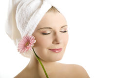 Young beautiful healthy woman with pink flower Stock Images