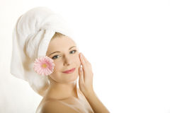 Young beautiful healthy woman with pink flower Royalty Free Stock Photos