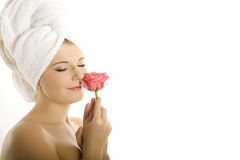Young beautiful healthy woman with pink rose Royalty Free Stock Photos