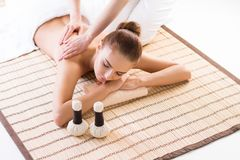Young, beautiful and healthy woman relaxing in spa salon. Stock Photo