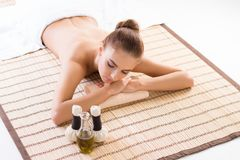 Young, beautiful and healthy woman relaxing in spa salon. Stock Image
