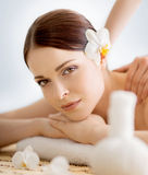 Young, beautiful and healthy woman in spa salon. Traditional ori Stock Photography