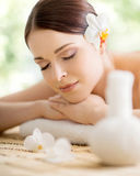 Young, beautiful and healthy woman in spa salon. Traditional ori Stock Photo
