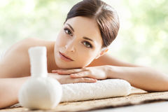 Young, beautiful and healthy woman in spa salon. Traditional ori Stock Image