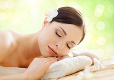 Young, beautiful and healthy woman in spa salon. Traditional ori Stock Images