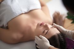 Young, beautiful and healthy woman in spa salon. Traditional oriental massage therapy and beauty treatments. Royalty Free Stock Photography