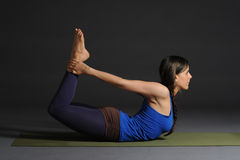 Young beautiful healthy yoga woman instructor doing yoga in photo studio. Stock Photos
