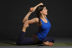 Young beautiful healthy yoga woman instructor doing yoga in photo studio. Royalty Free Stock Photography