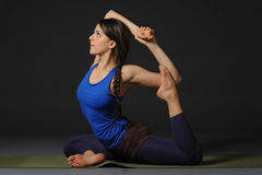 Young beautiful healthy yoga woman instructor doing yoga in photo studio. Stock Photography