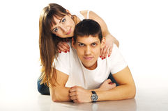 Young beautiful heterosexual couple. Portrait of young beautiful heterosexual couple on white background Royalty Free Stock Images