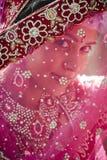 Young beautiful Hindu bride looking through jeweled veil. At camera Royalty Free Stock Images