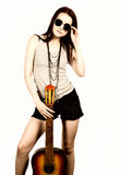 Young beautiful hippie playing guitar on light background royalty free stock photo