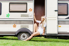 Young and beautiful hippy girl sitting on trailer. Stock Photos