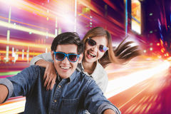 Young couple in sunglasses riding on motorbike. Young beautiful hipster couple in sunglasses riding on motorbike at city street Stock Images