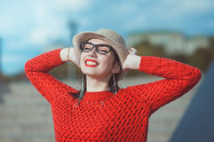 Young beautiful hipster girl in hat and glasses enjoy sunlight Stock Photo