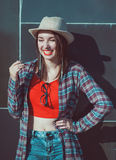 Young beautiful hipster girl in the hat laughing Stock Image