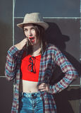 Young beautiful hipster girl in the hat surprised Royalty Free Stock Photography
