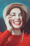 Young beautiful hipster girl in red jersey with hat laughing Stock Photography
