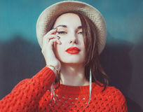 Young beautiful hipster girl in red jersey with hat Stock Photo