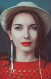 Young beautiful hipster girl in red jersey with hat Royalty Free Stock Photography