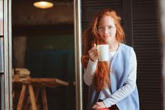 Young hipster student woman or creative freelance designer on the work. Morning in home office or art studio. Stock Image