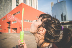 Young beautiful hipster woman bubble blower Stock Images