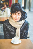 Young beautiful hipster woman at the coffee bar Stock Photos