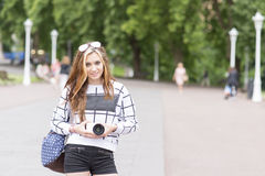 Young beautiful hipster woman with digital camera in the street. Stock Images