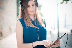 Young beautiful hipster woman listening music Stock Images