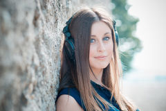 Young beautiful hipster woman listening music Stock Photos