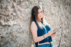 Young beautiful hipster woman listening music Stock Image
