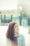Young beautiful hipster woman with red curly hair Stock Photography