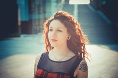 Young beautiful hipster woman with red curly hair Stock Images