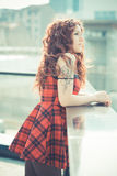 Young beautiful hipster woman with red curly hair Royalty Free Stock Photo
