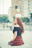 Young beautiful hipster woman with red curly hair Stock Photos