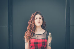 Young beautiful hipster woman with red curly hair Royalty Free Stock Image