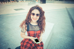 Young beautiful hipster woman with red curly hair Royalty Free Stock Images