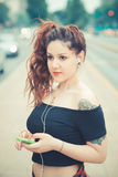 Young beautiful hipster woman with red curly hair Royalty Free Stock Photography