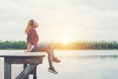 Free Young Beautiful Hipster Woman Sitting On The Lake Pier ,Relaxed Royalty Free Stock Images - 112828869