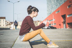 Young beautiful hipster woman using smart phone Royalty Free Stock Image