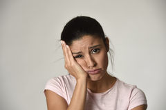 Young beautiful hispanic sad woman serious and concerned in worried depressed facial expression. Young beautiful hispanic sad woman serious and concerned looking Royalty Free Stock Photography
