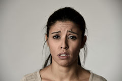 Young beautiful hispanic sad woman serious and concerned in worried depressed facial expression Stock Photography