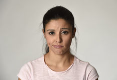 Young beautiful hispanic sad woman serious and concerned in worried depressed facial expression Stock Photo