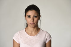 Young beautiful hispanic sad woman serious and concerned in worried depressed facial expression. Young beautiful hispanic sad woman serious and concerned looking Royalty Free Stock Photo