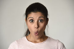 Young beautiful hispanic surprised woman amazed in shock and surprise with mouth big opened. Head portrait of young beautiful latin surprised woman amazed in Stock Images